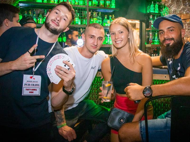 image showing 4 people having fun in a krakow bar