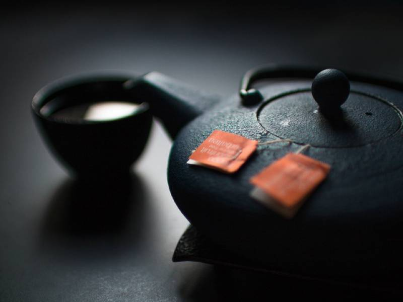 image of a kettle with green tea